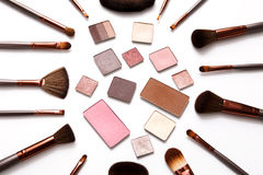 Decorative eyeshadow and makeup brushes flat lay Royalty Free Stock Photography