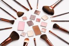 Decorative eyeshadow and makeup brushes flat lay Royalty Free Stock Image