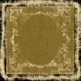 Decorative Fabric Grunge. Decorative old-fashioned oval vintage retro cloth background design with ornate floral elements border on a grunge fabric in brown royalty free illustration