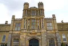 Decorative facade with castellated turrets and sculptures Royalty Free Stock Photo