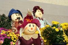 Decorative fall scarecrows Stock Photos