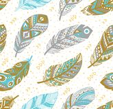 Tribal feathers pattern in grey, gold and blue colors. Vector illustration. Decorative feathers pattern. Tribal feathers in grey, gold and blue colors. Ideal for royalty free stock image