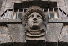 Decorative feature ancient building in the form of a female head Royalty Free Stock Photo
