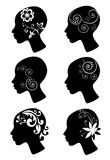 Decorative female heads Stock Photography