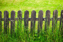 Decorative fence against green lawn background Royalty Free Stock Photos