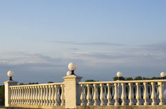 Decorative fence of columns on promenade on background of blue sky Royalty Free Stock Image