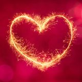 Decorative festive red background with glowing heart Stock Photography