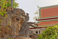 Decorative figure in rock garden. Wat Pho Temple of the Reclining Buddha. Bangkok, Thailand. Stock Images