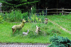 Decorative figures of deer family and kids Stock Image
