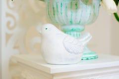 Decorative figurine birds. Decor of flowers of wedding ceremony in restaurant Royalty Free Stock Photos