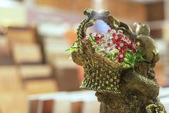 Decorative figurine of a rabbit with a basket of flowers stock image