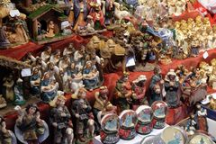 Decorative figurine on stall with decorations for winter holidays at traditional annual Christmas market in Zagreb. Croatia Stock Photos