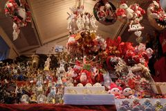 Decorative figurine on stall with decorations for winter holidays at traditional annual Christmas market in Zagreb. Croatia Royalty Free Stock Photo
