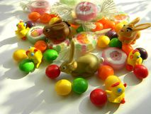 Decorative figurines of chickens and rabbits, candies. Easter decoration. Stock Image