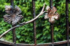 Decorative finish of metal fencing with forged elements. Leaves.  royalty free stock images