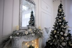 Decorative fireplace decorated with garlands. Christmas decoration of the house.Comfort. Decorative fireplace decorated with garlands. Christmas decoration of royalty free stock photo