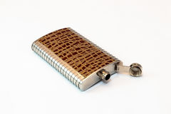 Decorative flask made of stainless steel decorated with crocodil Royalty Free Stock Photography