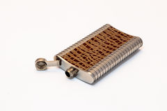 Decorative flask made of stainless steel decorated with crocodil Royalty Free Stock Photo