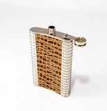 Decorative flask made of stainless steel decorated with crocodil Stock Image