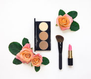 Decorative flat lay composition with cosmetics and flowers. Flat lay, top view Royalty Free Stock Photos