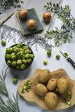 Decorative vegetables scene. Brussels sprouts, potatoes and onions  book royalty free stock photo