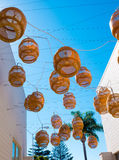 Decorative Floating lanterns hang above an alleyway in Malibu. Decorative natural fiber lanterns hang above an alley in Malibu Village Stock Photo