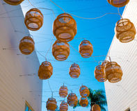 Decorative Floating lanterns hang above an alleyway in Malibu. Decorative natural fiber lanterns hang above an alley in Malibu Village, California Royalty Free Stock Images