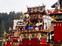 Decorative floats lining up the street at Takayama Autumn Festival. Takayama, Japan - October 9, 2015: Lavishly decorated floats on the street during Autumn Royalty Free Stock Photo