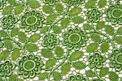 floral lace background. A decorative floral lace  background of green l leaves and flowers Stock Photos