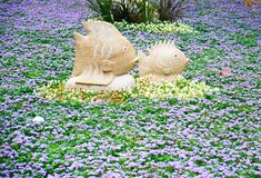 The decorative floral composition with stone fish in Gulhane Park, Istanbul stock photos