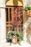 Decorative flower arrangement near the door of the Italian house Stock Photos
