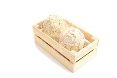 Decorative flower arrangement in a wooden box Royalty Free Stock Images