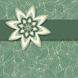 Decorative flower on a continuous pattern of green leaves Stock Photography
