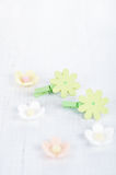 Decorative flower pegs with sugar flowers on white old table Stock Photo