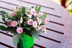 Decorative flower on table. Decorative flower on wood table Stock Photos
