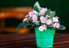 Decorative flower on table. Decorative flower on wood table Stock Photo