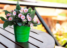 Decorative flower on table. Decorative flower on wood table Royalty Free Stock Image