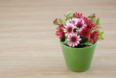 Decorative flower on wooden desk Royalty Free Stock Photos