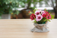 Decorative flower on wooden desk Stock Photo
