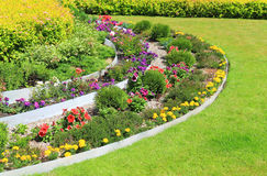 Decorative flowerbed on a lawn Stock Image