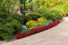 Decorative flowerbeds with flowers and bushes in landscape park. Decorative flowerbeds with flowers and bushes in the city`s landscape park royalty free stock photography