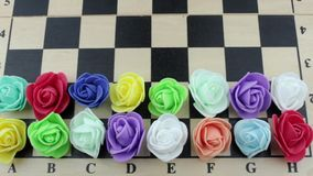 Decorative roses on a chessboard stock video footage