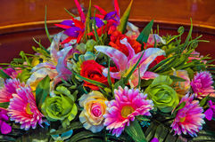 Decorative flowers on dinner table Stock Photo