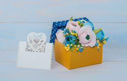 Decorative flowers in a gift box Stock Images