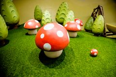 Decorative fly agaric on a green lawn.red mushrooms decoration.many mushrooms, big toys ,ornament.Fairy forest with royalty free stock photo