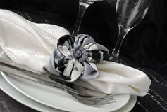 Decorative folded napkin on a plate with cutlery Stock Photos