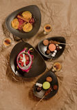 Decorative food. Decorative appetizers for a holiday in designer plates Royalty Free Stock Image