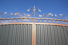 Decorative, forged barrier, fence in old stiletto Stock Photos