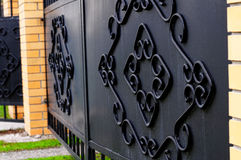 Decorative forged black iron gate Royalty Free Stock Images
