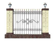 Decorative forged fence with pillar. Royalty Free Stock Image